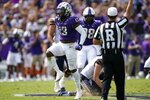 TCU linebacker Dee Winters (13) celebrates sacking California quarterback Chase Garbers, bottom right, in the first half of an NCAA college football game in Fort Worth, Texas, Saturday, Sept. 11, 2021. (AP Photo/Tony Gutierrez)