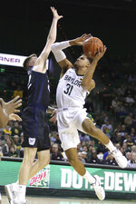 FLE - In this Dec. 10, 2019, file photo, Baylor guard MaCio Teague shoots over Butler forward Sean McDermott, left, in the first half of an NCAA college basketball game in Waco, Texas. Baylor All-Big 12 guard Jared Butler announced his intentions to enter his name into the NBA draft pool while keeping open his options to return to the Bears for his junior season, Monday, April 20, 2020. Teague announced his decision to enter the draft last month. (AP Photo/Rod Aydelotte, File)