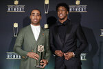 AP Defensive Player of the Year New England Patriots' Stephon Gilmore, left, and AP Offensive Player of the Year New Orleans Saints' Michael Thomas, pose with their trophies at the NFL Honors football award show Saturday, Feb. 1, 2020, in Miami. (AP Photo/Patrick Semansky)