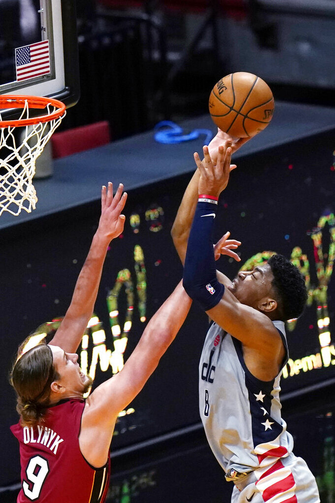 Washington Wizards forward Rui Hachimura, right, is fouled by Miami Heat forward Kelly Olynyk (9) during the second half of an NBA basketball game Wednesday, Feb. 3, 2021, in Miami. (AP Photo/Lynne Sladky)