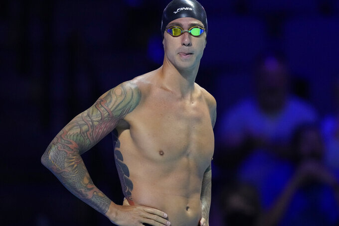 Tony Ervin gets ready to compete in a men's 50-meter freestyle preliminary heat during wave 2 of the U.S. Olympic Swim Trials on Saturday, June 19, 2021, in Omaha, Neb. (AP Photo/Charlie Neibergall)