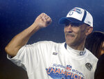 "FILE - In this Feb. 4, 2007, file photo, Indianapolis Colts coach Tony Dungy celebrates after beating the Chicago Bears 29-17, in the Super Bowl XLI football game in Miami. In 2003, the NFL had three minority head coaches: future Pro Football Hall of Famer Dungy, Herman Edwards and Marvin Lewis. In the 12 previous seasons, there had been six. Total. Considering that the majority of the players in the league 16 years ago were minorities, that imbalance was enormous. And disturbing. And, frankly, it was unfair. Paul Tagliabue, then the NFL commissioner, put together a committee that established the ""Rooney Rule,"" which requires all teams with coaching and front office vacancies to interview minority candidates. The rule, long overdue, was named for Dan Rooney, then president of the Pittsburgh Steelers and the overseer of that committee.  (AP Photo/Chris Carlson, File)"