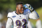 Baltimore Ravens defensive tackle Justin Madubuike pours water on his face during a break at a joint practice hosted by Carolina Panthers at the NFL football team's training camp in Spartanburg, S.C., Wednesday, Aug. 18, 2021. (AP Photo/Nell Redmond)