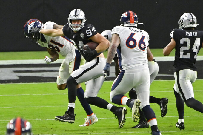 Las Vegas Raiders defensive end Carl Nassib (94) runs after making an interception against the Denver Broncos during the second half of an NFL football game, Sunday, Nov. 15, 2020, in Las Vegas. (AP Photo/David Becker)