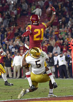 Southern California wide receiver Tyler Vaughns, top, makes a touchdown catch as Notre Dame cornerback Troy Pride Jr. tackles him during the second half of an NCAA college football game Saturday, Nov. 24, 2018, in Los Angeles. Notre Dame won 24-17. (AP Photo/Mark J. Terrill)