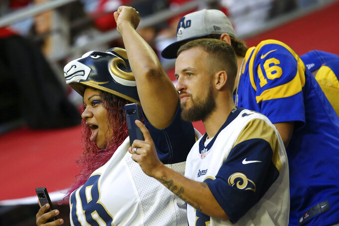 Los Angeles Rams fans cheer during the first half of an NFL football game against the Arizona Cardinals, Sunday, Dec. 1, 2019, in Glendale, Ariz. (AP Photo/Ross D. Franklin)