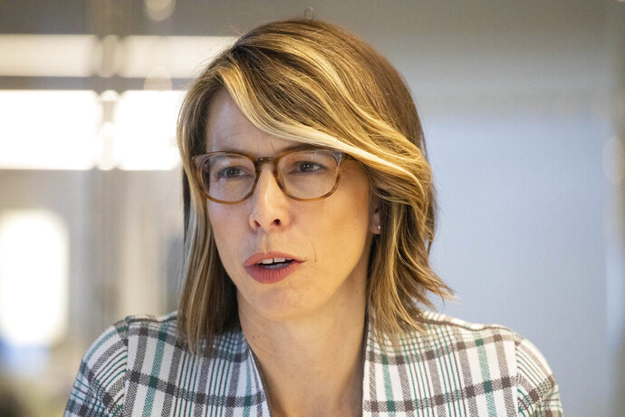 In this Nov. 18, 2019, photo Sally Hubbard, the director of enforcement strategy at Open Markets Institute, talks during an interview in New York. Hubbard is an antitrust expert who is director of enforcement strategy at the Open Markets Institute, whose central mission is to call attention to the risks of corporate monopolization. (AP Photo/Mark Lennihan)