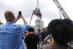 EDS NOTE: OBSCENITY - Work crews remove the statue of confederate general Stonewall Jackson, Wednesday, July 1, 2020, in Richmond, Va. Richmond Mayor Levar Stoney has ordered the immediate removal of all Confederate statues in the city, saying he was using his emergency powers to speed up the healing process for the former capital of the Confederacy amid weeks of protests over police brutality and racial injustice. (AP Photo/Steve Helber)