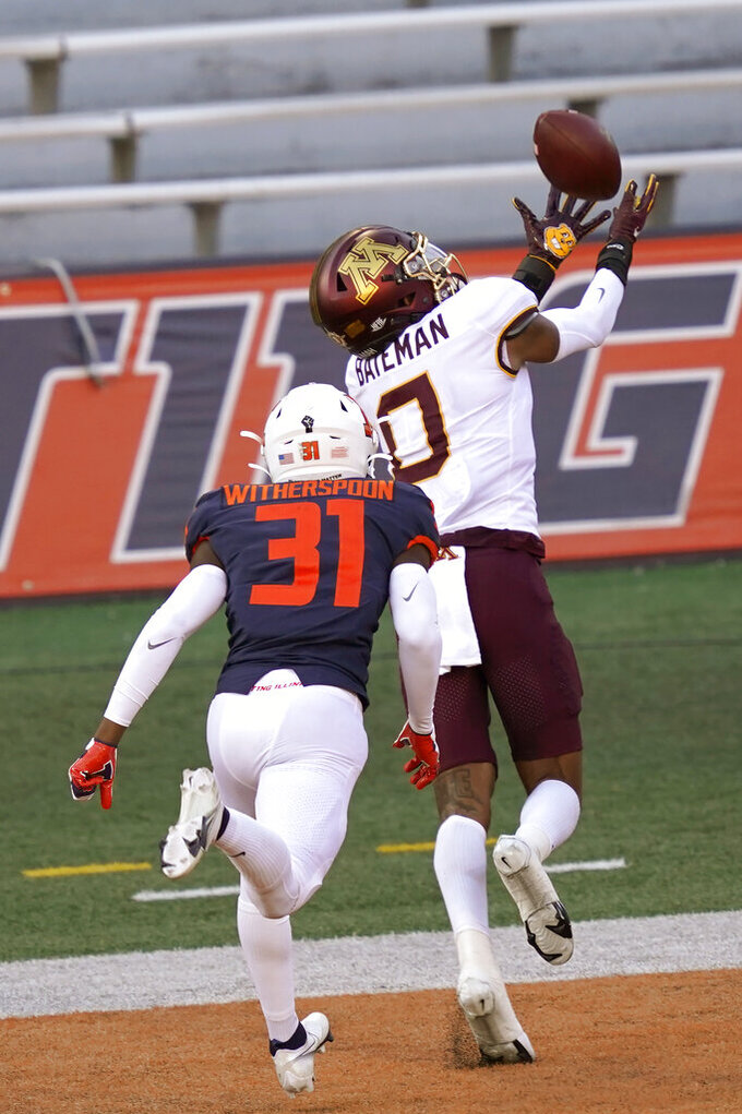 Minnesota wide receiver Rashod Bateman (0) catches a touchdown pass from quarterback Tanner Morgan, as Illinois defensive back Devon Witherspoon defends during the first half of an NCAA college football game Saturday, Nov. 7, 2020, in Champaign , Ill. (AP Photo/Charles Rex Arbogast)