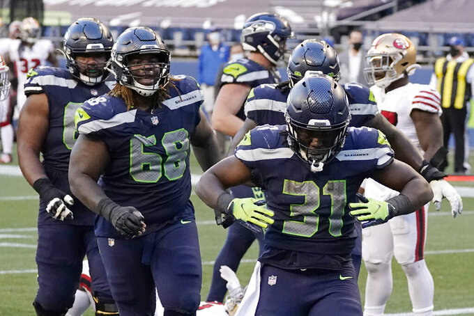 Seattle Seahawks running back DeeJay Dallas (31) celebrates after scoring a touchdown against the San Francisco 49ers during the second half of an NFL football game, Sunday, Nov. 1, 2020, in Seattle. (AP Photo/Elaine Thompson)