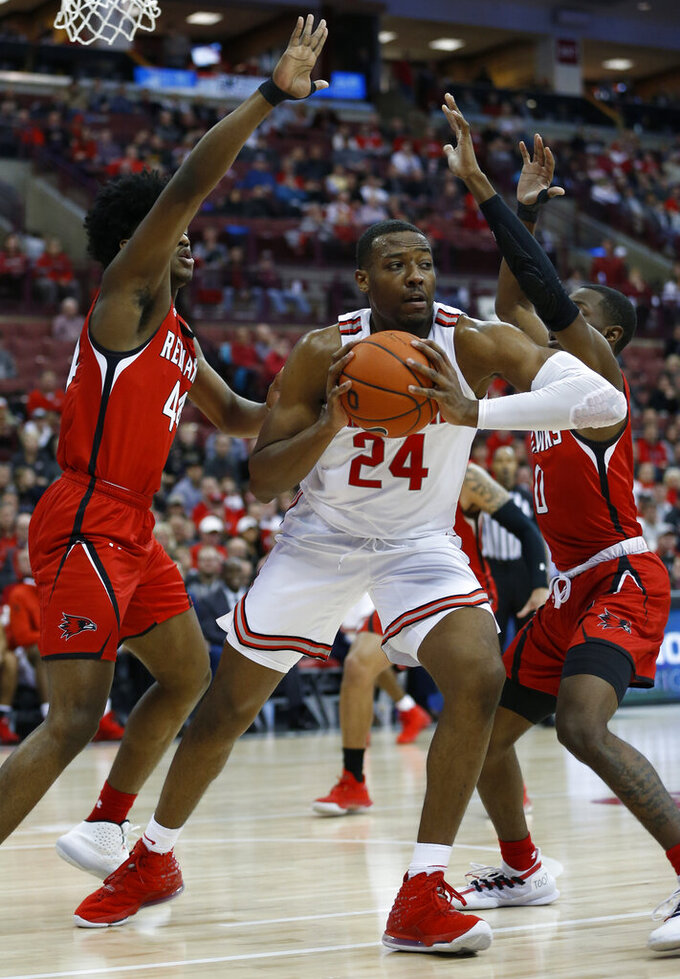 Ohio State's Andre Wesson, center, grabs a rebound between Southeast Missouri State's Darrious Agnew, left, and Alex Caldwell during the second half of an NCAA college basketball game Tuesday, Dec. 17, 2019, in Columbus, Ohio. Ohio State defeated Southeast Missouri State 80-48. (AP Photo/Jay LaPrete)