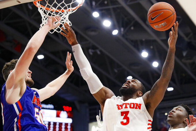 Dayton's Trey Landers (3) reaches for a rebound against Houston Baptist's Ryan Gomes, left, during the first half of an NCAA college basketball game, Tuesday, Dec. 3, 2019, in Dayton, Ohio. (AP Photo/John Minchillo)