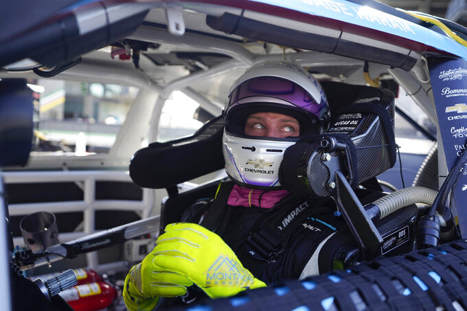 Sage Karam waits in his car during qualifications for the NASCAR Xfinity Series at Indianapolis Motor Speedway, Saturday, Aug. 14, 2021, in Indianapolis. (AP Photo/Darron Cummings)