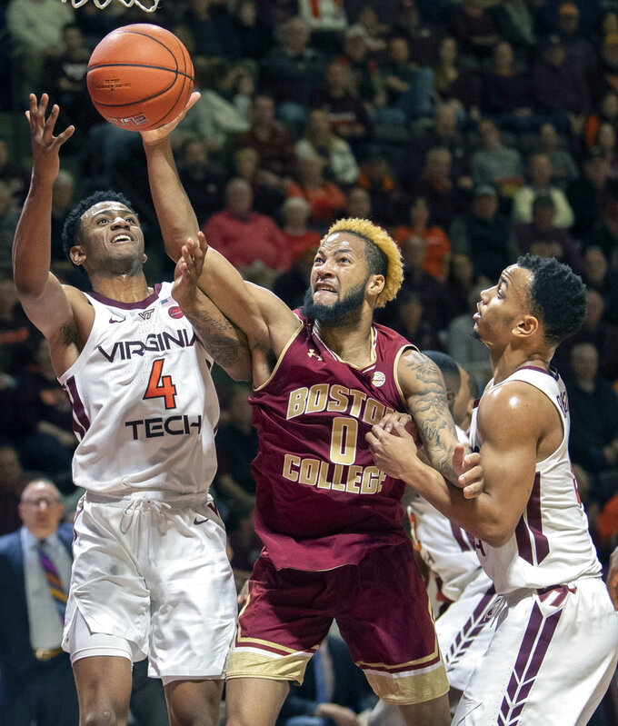 Boston College guard Ky Bowman (0), Virginia Tech guards Nickeil Alexander-Walker (4) and Justin Robinson (5) battle for a rebound during the first half of an NCAA college basketball game Saturday, Jan. 5, 2019, in Blacksburg, Va. Tech won 77-66. (AP Photo/Don Petersen)