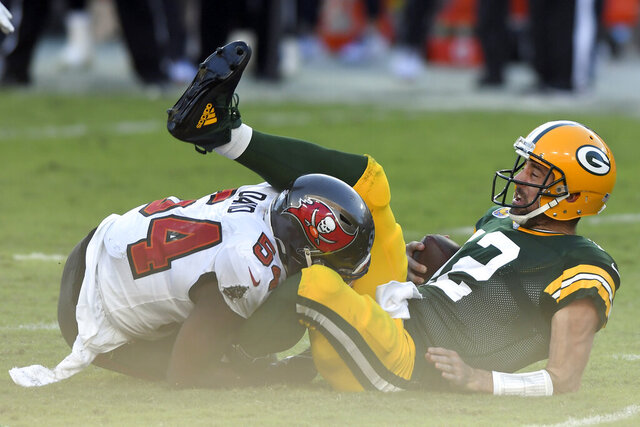 Green Bay Packers quarterback Aaron Rodgers (12) gets sacked by Tampa Bay Buccaneers inside linebacker Lavonte David (54) during the first half of an NFL football game Sunday, Oct. 18, 2020, in Tampa, Fla. (AP Photo/Jason Behnken)