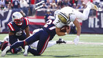 New Orleans Saints quarterback Taysom Hill (7) is taken down by New England Patriots cornerback J.C. Jackson (27) during the first half of an NFL football game, Sunday, Sept. 26, 2021, in Foxborough, Mass. (AP Photo/Mary Schwalm)