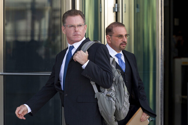 FILE - In this Nov. 19, 2019, file photo, Douglas Haig, left, and his attorney, Marc Victor leave the Lloyd George Federal Courthouse in Las Vegas, after pleading guilty to illegally manufacturing tracer and armor-piercing bullets found in a high-rise hotel suite where a gunman took aim before the Las Vegas Strip massacre two years ago. Haig is a 57-year-old aerospace engineer who used to reload bullets at home in Mesa, Airz., and sell them at gun shows. Douglas Haig has been sentenced to 13 months in federal prison after selling home-loaded bullets to the gunman who killed 58 people in the Las Vegas Strip shooting in Oct. 2017. Haig, 57, also was sentenced Tuesday, June 30, 2020, in Las Vegas to three years of supervised release after pleading guilty last November to illegally manufacturing ammunition. (Elizabeth Page Brumley/Las Vegas Review-Journal via AP, File)