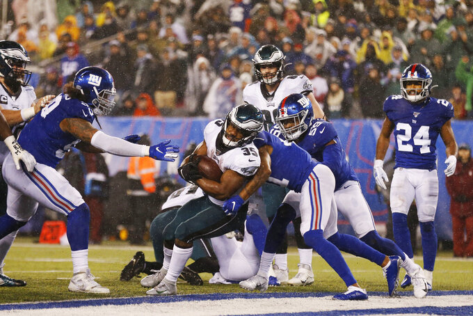 Philadelphia Eagles running back Boston Scott (35) scores a touchdown in the second half of an NFL football game against the New York Giants, Sunday, Dec. 29, 2019, in East Rutherford, N.J. (AP Photo/Adam Hunger)