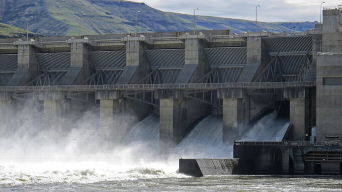 FILE - In this April 11, 2018, file photo, water moves through a spillway of the Lower Granite Dam on the Snake River near Almota, Wash. Some Republican members of Congress from the Northwest are accusing a GOP Idaho lawmaker of conducting secret negotiations with the Democratic governor of Oregon over a controversial proposal to breach four dams on the Snake River to save endangered salmon runs. (AP Photo/Nicholas K. Geranios, File)