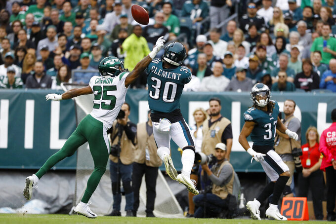 Philadelphia Eagles' Corey Clement, right, cannot catch a punt as New York Jets' Trenton Cannon recovers the turnover during the second half of an NFL football game, Sunday, Oct. 6, 2019, in Philadelphia. (AP Photo/Michael Perez)