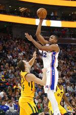 Philadelphia 76ers forward Al Horford (42) shoots as Utah Jazz forward Bojan Bogdanovic defends during the second half of an NBA basketball game Wednesday, Nov. 6, 2019, in Salt Lake City. (AP Photo/Rick Bowmer)