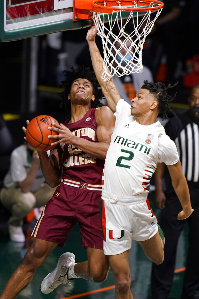 Boston College guard DeMarr Langford Jr. goes up to shoot against Miami guard Isaiah Wong (2) during the first half of an NCAA college basketball game, Friday, March 5, 2021, in Coral Gables, Fla. (AP Photo/Wilfredo Lee)