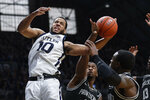 Butler forward Bryce Nze (10) is fouled by Providence guard Alpha Diallo (11) in the first half of an NCAA college basketball game in Indianapolis, Saturday, Feb. 1, 2020. (AP Photo/Michael Conroy)