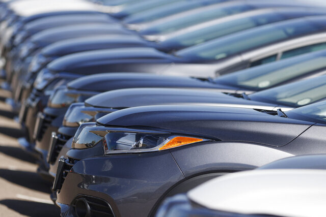 FILE - In this file photo dated June 7, 2020, a long row of unsold cars at a Honda dealership in Highlands Ranch, Colo.  The coronavirus pandemic is causing drivers to keep their cars and trucks longer.  The IHS Markit consulting firm says the pandemic has caused consumers to put the brakes on spending and hold onto their current vehicles for a longer period.    (AP Photo/David Zalubowski, File)