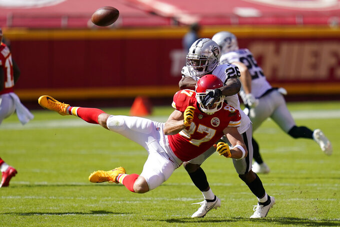 Las Vegas Raiders cornerback Nevin Lawson (26) breaks up a pass intended for Kansas City Chiefs tight end Travis Kelce during the second half of an NFL football game, Sunday, Oct. 11, 2020, in Kansas City. (AP Photo/Jeff Roberson)