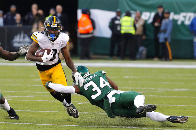 Pittsburgh Steelers wide receiver Diontae Johnson (18) is stopped by New York Jets cornerback Brian Poole (34) in the second half of an NFL football game, Sunday, Dec. 22, 2019, in East Rutherford, N.J. (AP Photo/Seth Wenig)