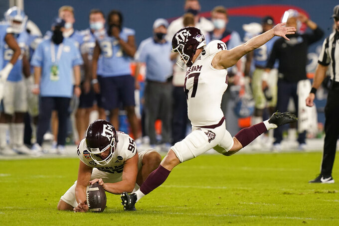 Texas A&M place kicker Seth Small (47) kicks a field goal as punter Nik Constantinou (95) holds, during the first half of the Orange Bowl NCAA college football game against North Carolina, Saturday, Jan. 2, 2021, in Miami Gardens, Fla. (AP Photo/Lynne Sladky)