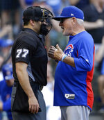 Chicago Cubs' Joe Maddon argues with an umpire during the eighth inning of a baseball game against the Milwaukee Brewers, Wednesday, June 13, 2018, in Milwaukee. (AP Photo/Aaron Gash)