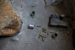 Empty bullet cartridges lie inside the house near the site of a gunbattle between Indian soldiers and suspected militants in Shopian, south of Srinagar, Indian controlled Kashmir, Friday, April 9, 2021. Seven suspected militants were killed and four soldiers wounded in two separate gunfights in Indian-controlled Kashmir, officials said Friday, triggering anti-India protests and clashes in the disputed region. (AP Photo/ Dar Yasin)