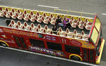 FILE - In this March 12, 2020, file photo, tourists sit in a mostly empty sightseeing bus on Hollywood Boulevard in the Hollywood section of Los Angeles. Los Angeles and San Francisco are poised Tuesday, May 4,  2021, to be the only major urban areas in the state to meet guidelines to move into the least-restrictive tier. (AP Photo/Chris Pizzello, File)