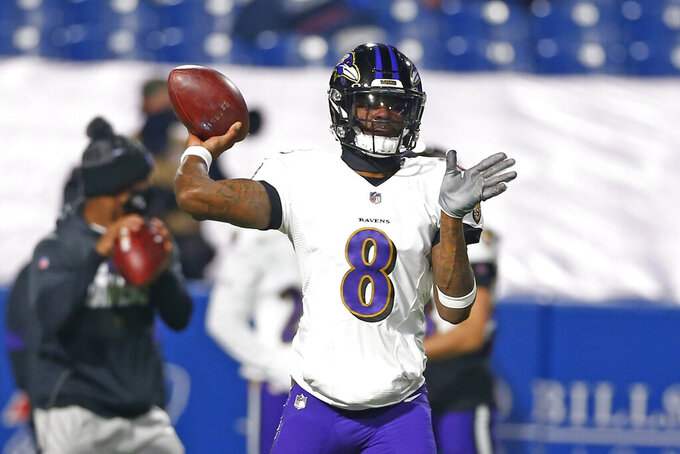 Baltimore Ravens quarterback Lamar Jackson (8) warms up before an NFL divisional round football game against the Buffalo Bills Saturday, Jan. 16, 2021, in Orchard Park, N.Y. (AP Photo/John Munson)