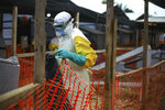An Ebola health worker is seen at a treatment centre in Beni, Eastern Congo, Tuesday April,16, 2019. Congo's president on Tuesday said he wants to see a deadly Ebola virus outbreak contained in less than three months even as some health experts say it could take twice as long. (AP Photo/Al-hadji Kudra Maliro)
