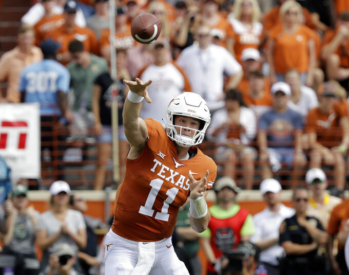 Texas QB Ehlinger leaves game with shoulder injury