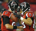 FILE - In this Sept. 17, 2012, file photo, Atlanta Falcons quarterback Matt Ryan (2) and tight end Tony Gonzalez, right, celebrate after a touchdown during the first half of an NFL football game against the Denver Broncos, in Atlanta. Matt Ryan believes Tony Gonzalez already was a lock for the Hall of Fame before being traded from Kansas City to Atlanta in 2009. Gonzalez will be inducted into the Pro Football Hall of Fame in Canton, Ohio on Aug. 3, 2019. (AP Photo/John Bazemore, File)