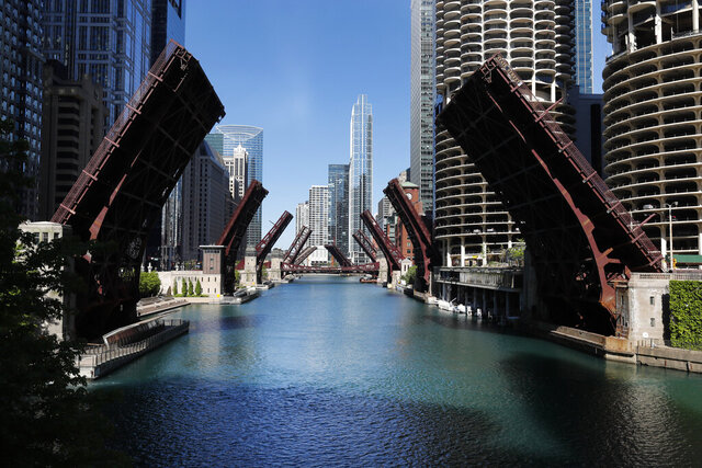 FILE - In this May 31, 2020 file photo, several street bridges over the Chicago River remain closed in Chicago, after a night of unrest and protests over the death of George Floyd, a black man who was in police custody in Minneapolis. The year 2020 ended in Chicago with more homicides than in all but one year in more than two decades.  As in other cities, Chicago police attribute much of the increase in gun violence to the global coronavirus pandemic and civil unrest that erupted after Floyd died after being forcibly detained by Minneapolis police. (AP Photo/Charles Rex Arbogast)