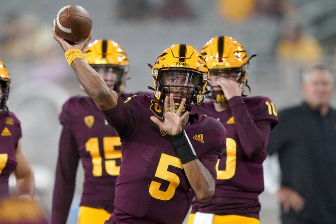 Arizona State quarterback Jayden Daniels (5) warms up prior to an NCAA college football game against Southern Utah, Thursday, Sept. 2, 2021, in Tempe, Ariz. (AP Photo/Matt York)