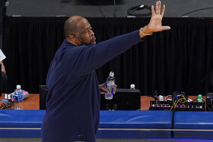 Georgetown coach Patrick Ewing calls out to players during the second half of the team's NCAA college basketball game against Creighton for the championship of the Big East men's tournament Saturday, March 13, 2021, in New York. Georgetown won 73-48. (AP Photo/Frank Franklin II)