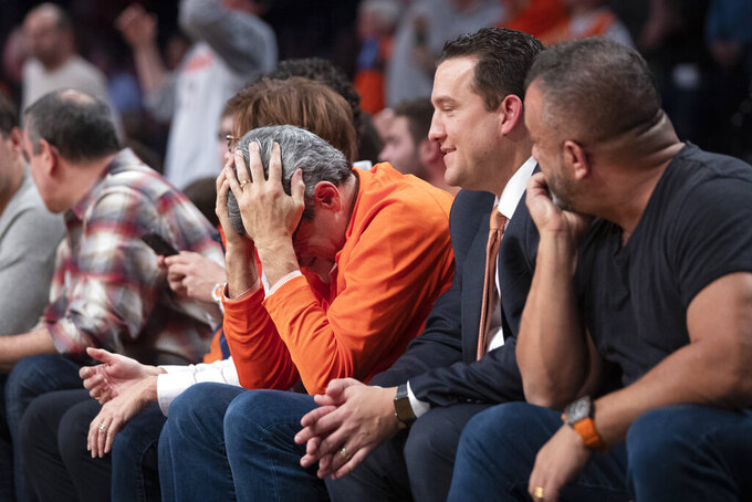 Syracuse fans react during the first half of an NCAA college semi final basketball game against the Oklahoma State in the NIT Season Tip-Off tournament, Wednesday, Nov. 27, 2019, in New York. (AP Photo/Mary Altaffer)