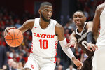 Dayton's Jalen Crutcher (10) drives past St. Bonaventure's Kyle Lofton (0) during the second half of an NCAA college basketball game, Wednesday, Jan. 22, 2020, in Dayton, Ohio. (AP Photo/John Minchillo)