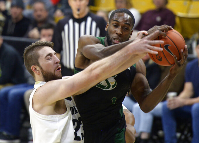 Colorado forward Lucas Siewert and Sacramento State forward Chibueze Jacobs battle for a rebound in the first half of an NCAA college basketball game, Saturday, Nov. 30, 2019, in Boulder, Colo. (AP Photo/Cliff Grassmick)
