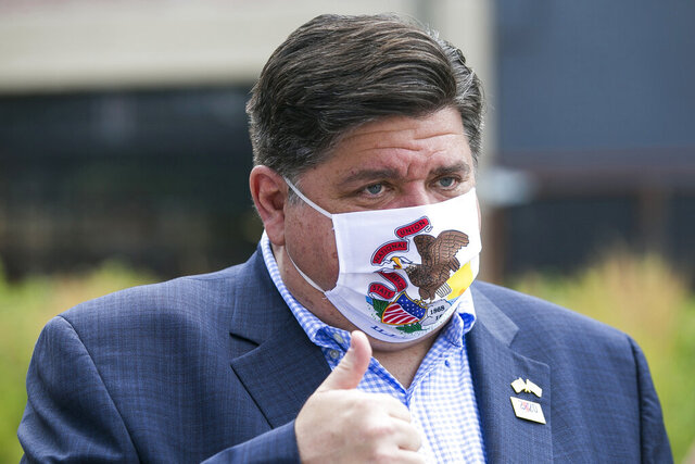 FILE - In this July 16, 2020, file photo, Illinois Gov. J.B. Pritzker meets with people at City Market in Rockford, Ill. Gov. Pritzker set guidelines for youth sports on Wednesday, July 29, 2020, because of incidents where COVID-19 spread at sports camps and even in Major League baseball, and he warned that the growing number of cases in Illinois could result in tougher restrictions on social interaction.(Scott P. Yates/Rockford Register Star via AP, File)