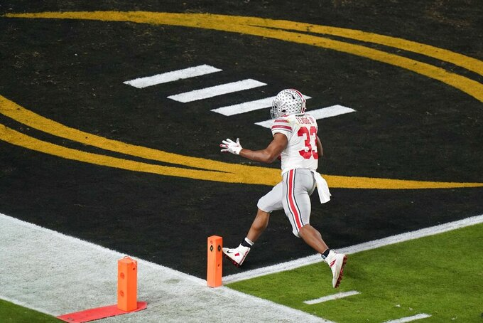 Ohio State running back Master Teague III scores a touchdown against Alabama during the first half of an NCAA College Football Playoff national championship game, Monday, Jan. 11, 2021, in Miami Gardens, Fla. (AP Photo/Wilfredo Lee)