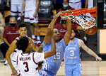 North Carolina forward Garrison Brooks (15) dunks past Stanford forward Ziaire Williams (3) in the first half of an NCAA college basketball game in the semifinals of the Maui Invitational tournament, Tuesday, Dec. 1, 2020, in Asheville, N.C. (AP Photo/Kathy Kmonicek)