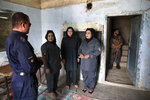 In this Thursday, Sept. 26, 2019 photo, Afghan police women assigned for security of polling station for women, train in one of thousands of polling stations, ahead of presidential elections scheduled for Sept. 28, in Kabul, Afghanistan. In conservative Afghanistan, men and women vote separately and that means thousands of women police will be deployed to search the women coming to vote. (AP Photo/Ebrahim Noroozi)