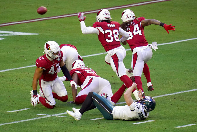 Arizona Cardinals linebacker Zeke Turner (47) looks at Philadelphia Eagles punter Cameron Johnston (1) after Turner blocked his punt during the first half of an NFL football game, Sunday, Dec. 20, 2020, in Glendale, Ariz. (AP Photo/Ross D. Franklin)