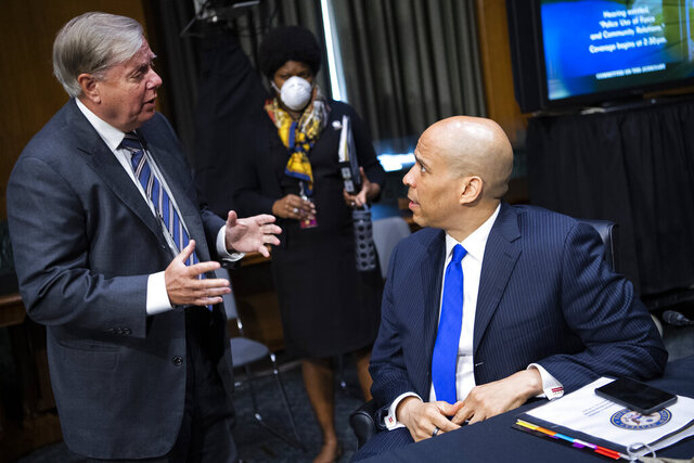 Chairman Lindsey Graham, R-S.C., left, talks with Sen. Cory Booker, D- N.J., prior to a Senate Judiciary Committee hearing on police use of force and community relations on on Capitol Hill, Tuesday, June 16, 2020 in Washington. (Tom Williams/CQ Roll Call/Pool via AP)